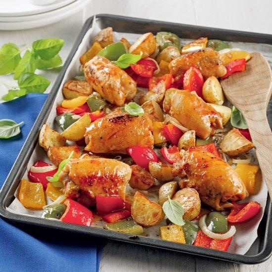 Hauts de cuisses marinés et légumes sur plaque