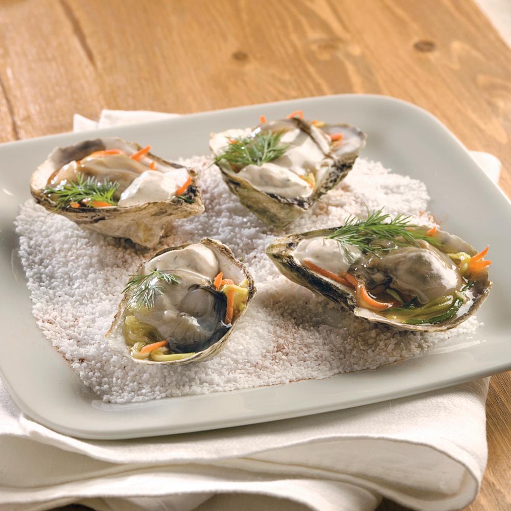 Huîtres en demi-coquilles et légumes