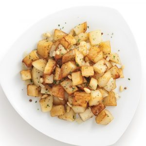 Pommes de terre sautées aux épices et noix de pin