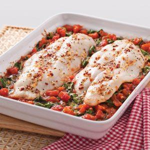 Filets de pangasius aux tomates et épinards